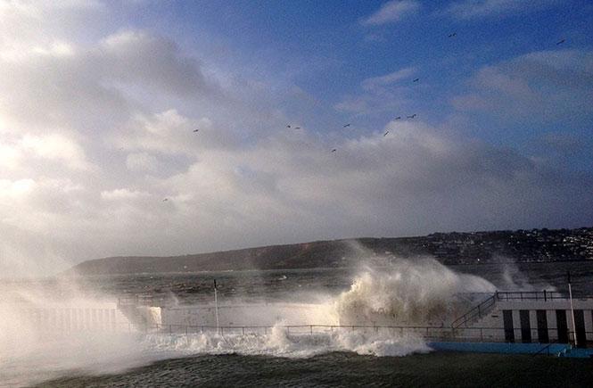 Waves crashing over Jubilee Pool