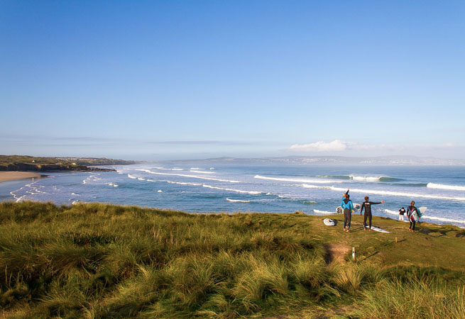 Surfers at Gwithian Beach